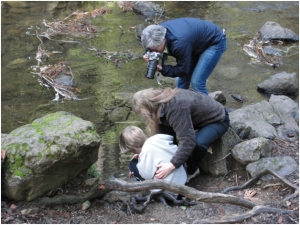 Student and parent releasing trout