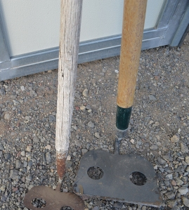Photo of worn vs good hoe handles