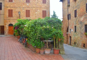 Outdoor restaurant with containter plants in Italy