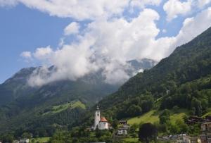 Mountain village and church in Switzerland